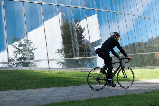 Urban cyclist in rides in business district