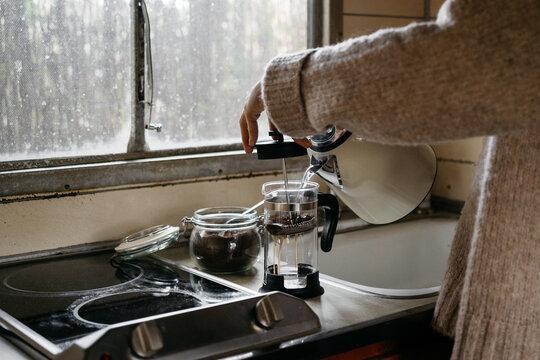 Anonymous woman preparing a coffe
