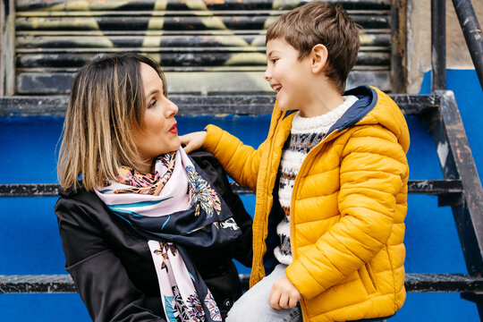 Mother and son talking at the street
