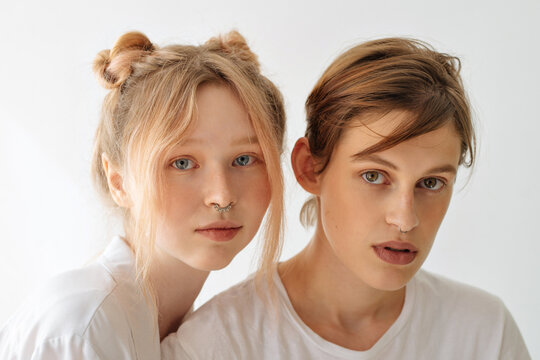 portrait of two beautiful young girls on a white background