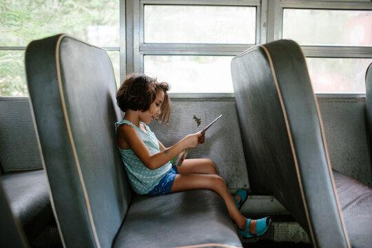 Kid inside an old school bus