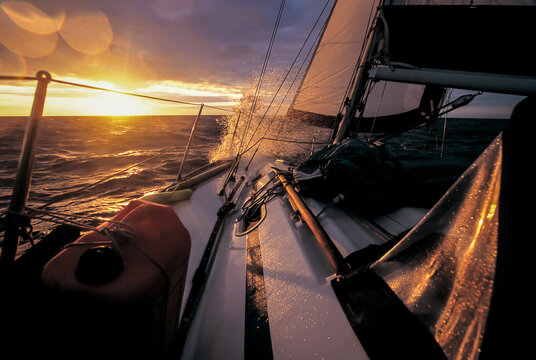 long haul sailboat sailing into the sunset