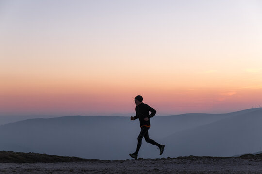 man running in sunset