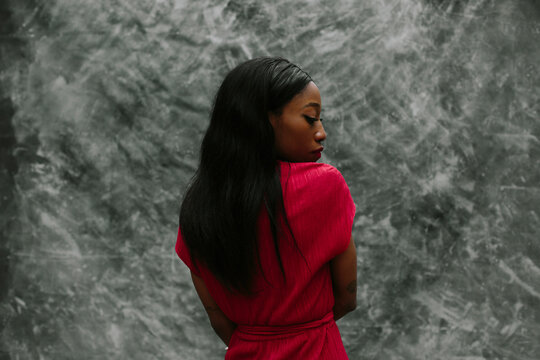 Profile portrait of Woman posing over grey background