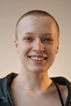 portrait of a blue-eyed bald girl with a smile