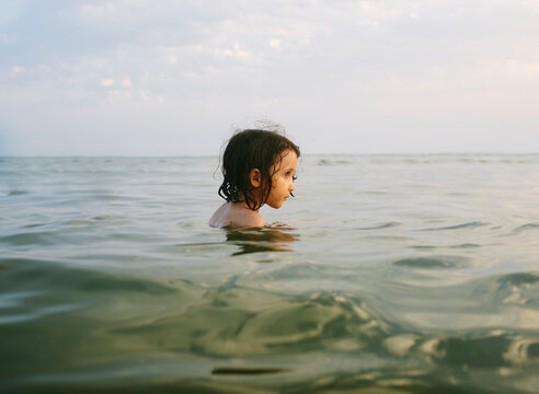 Kid floating in the sea