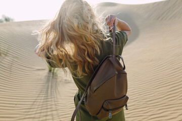 Woman with leather backpack