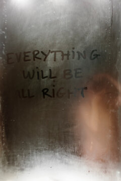 Steamy mirror in bathroom with positive message