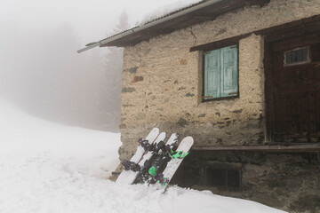 Snowboards outside a cottage on the mountain