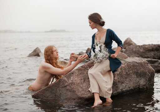 Love story between mermaid and girl with flowers