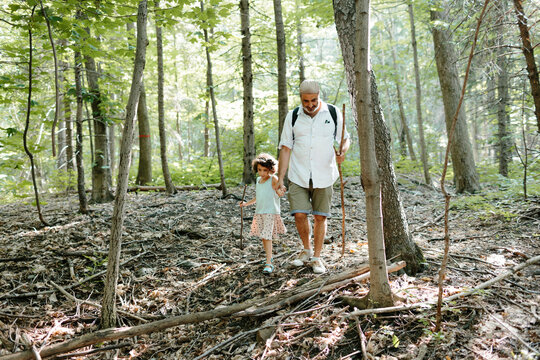 Kid and father in the woods