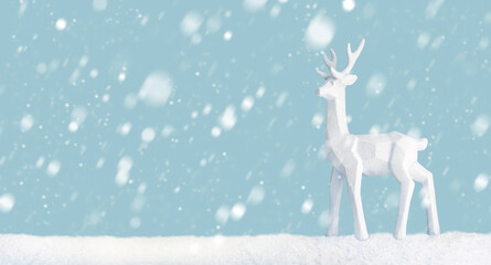 Scene of a deer in a snowy landscape with light blue background