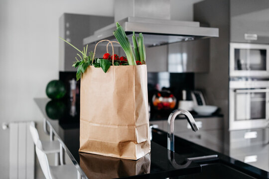 Paper bag of groceries on the kitchen counter