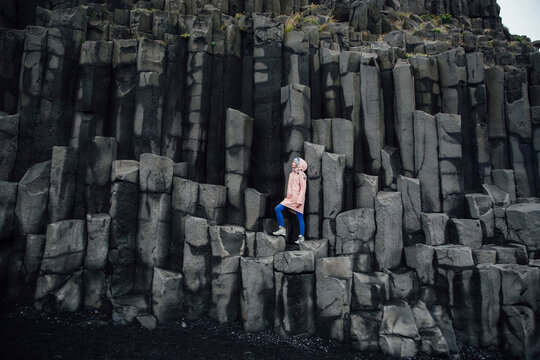 Woman standing on basalt rock formations
