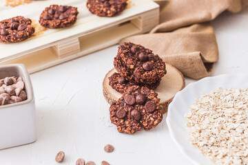 Top shot of a pile of oatmeal and banana chocolate cookies. Studio shot