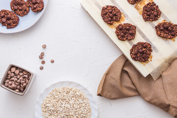 Overhead shot of freshly baked oatmeal and banana cookies with chocolate chips with some copy space.