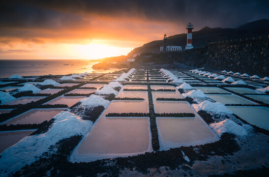Frozen water and snow on background of spectacular seascape at sundown in winter