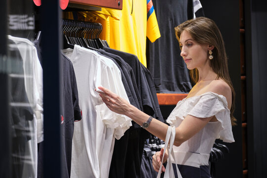 Pretty woman looking at clothes in a store