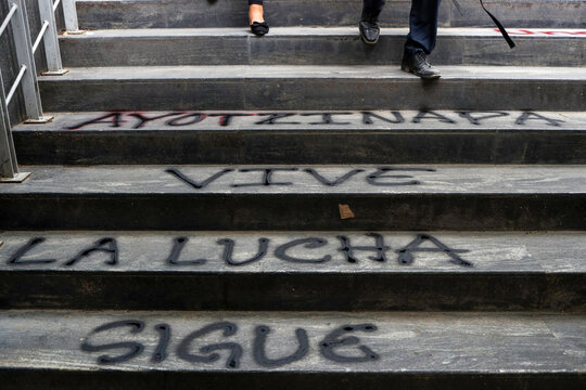 People go down the stairs during a protest outside the Attorney General's office, in Mexico City