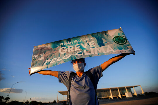 "Demonstrators take part in a Fridays for Future activists protest calling for a ""Global Day of Climate Action"" in Brasilia"