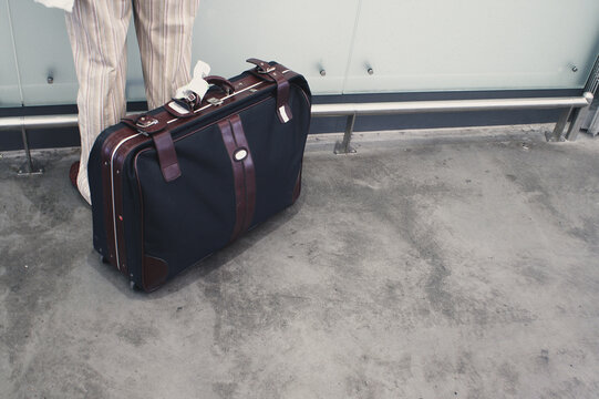 Traveler at airport checking in his luggage