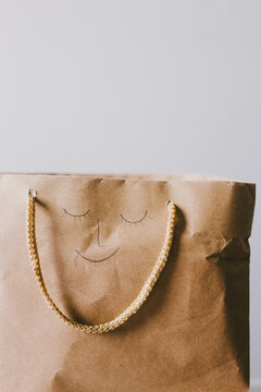 shopping bag with a smily face on it
