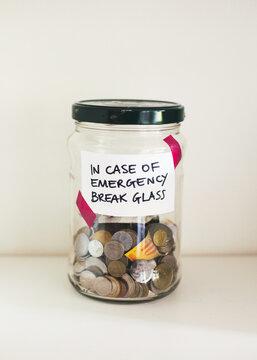 """Bank jar labelled """"""""In case of emergency break glass"""""""""""