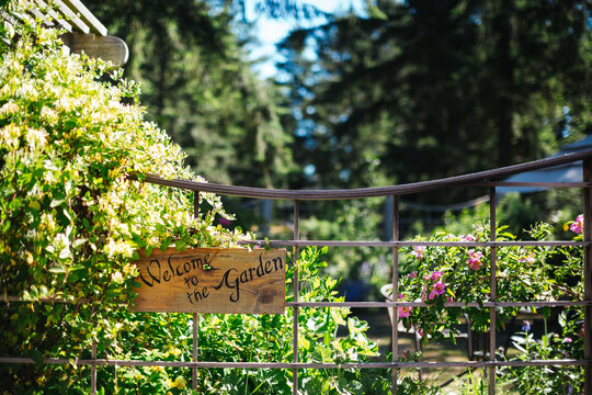Garden gate with welcome sign