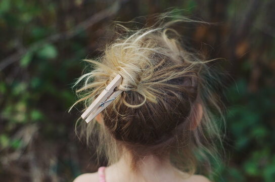 Little girl with a peg in her messy hair