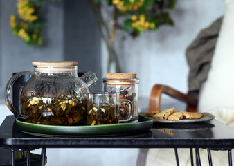 herbal hot tea in a teapot on the table