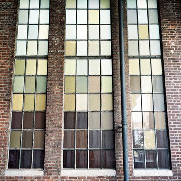 Large, green tinted warehouse windows