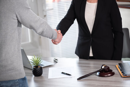 Handshake between female lawyer and male client
