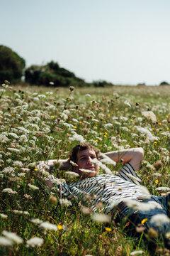 Lying in a meadow