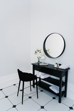 Dressing table in the bathroom with mirror and towel