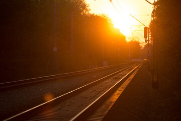 Empty railroad tracks with a beautiful sunset.