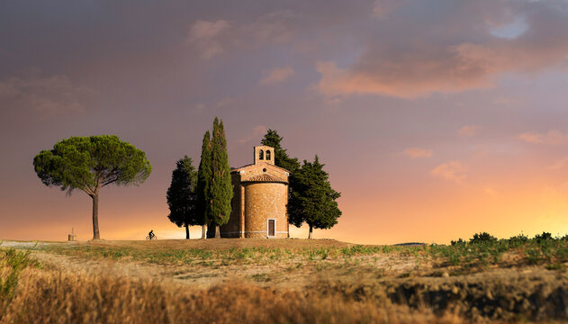Sunrise after the storm - Chapel in between trees in Tuscany, Italy