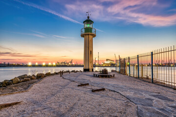 lighthouse on the shore of the sea