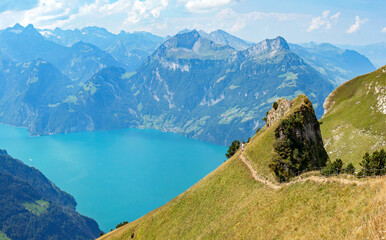 Photo sur Plexiglas Bleu jean Ridge walk along Lake Lucerne near Stoos, Switzerland, between Klingenstock and Fronalpstock (1.922m.); impressive views on the Alps