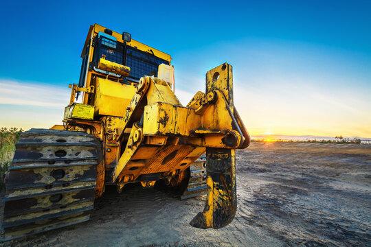 Large iron plow on bulldozer tractor.