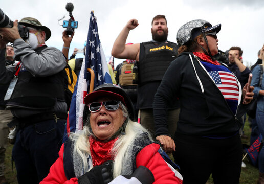 An elderly woman reacts during a rally of the far right group Proud Boys, in Portland