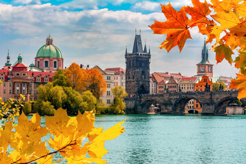 Prague cityscape and Charles bridge over Vltava river in autumn, Czech Republic