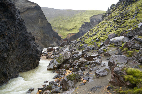 A green mountain with a beautiful river in the 54 km trek from Landmannalaugar, Iceland