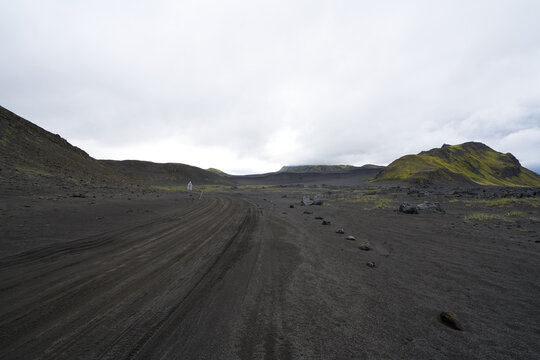 Vulcanic landscape in the highlands of iceland, black ash deserts with green moss