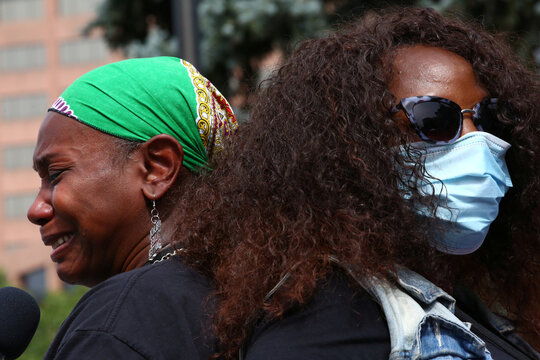 Protesters gather for a rally for Black women in Denver