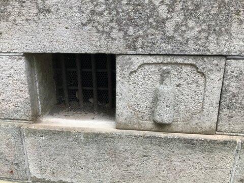 Old Stone Wall with Bin Motif
