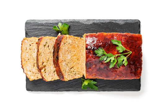 Tasty homemade ground baked chicken meatloaf glazed with barbeque sauce .	top view. isolated on white background