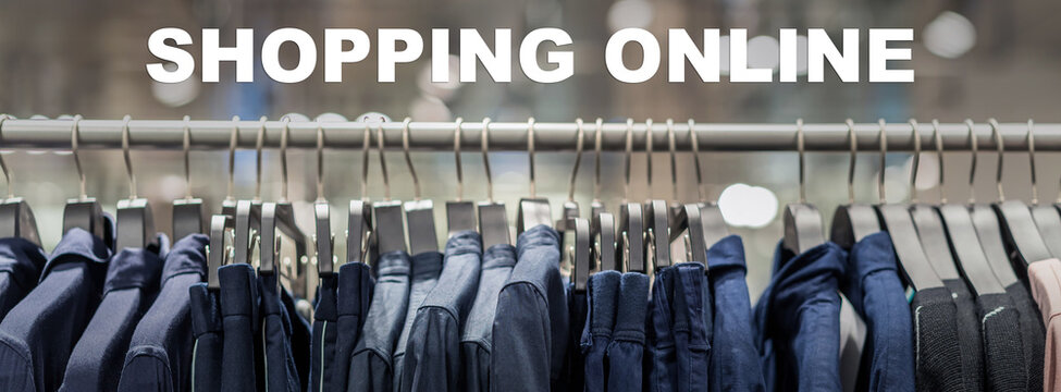 Shopping online text over Banner, web page of clothes rack in glasses fashion shop at shopping department store for display, copy space and paranomic ratio, business fashion and advertisement concept