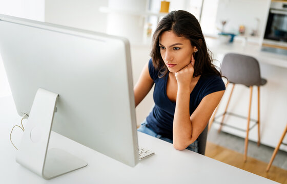 Beautiful young woman working on computer. Technology, people, work, study concept