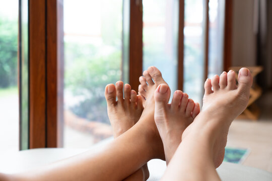 close up picture of LGBT lover feet who sleep together in bed at home