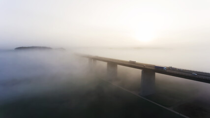 Highway bridge vanishing in the frosty fog